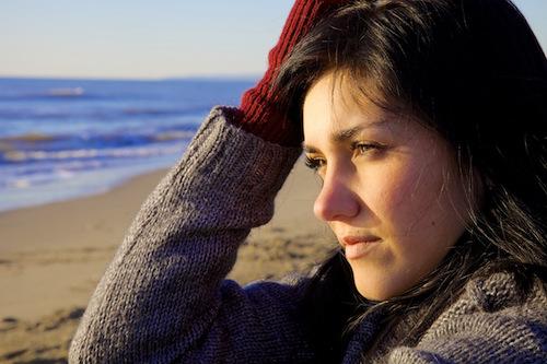 pensive woman on beach